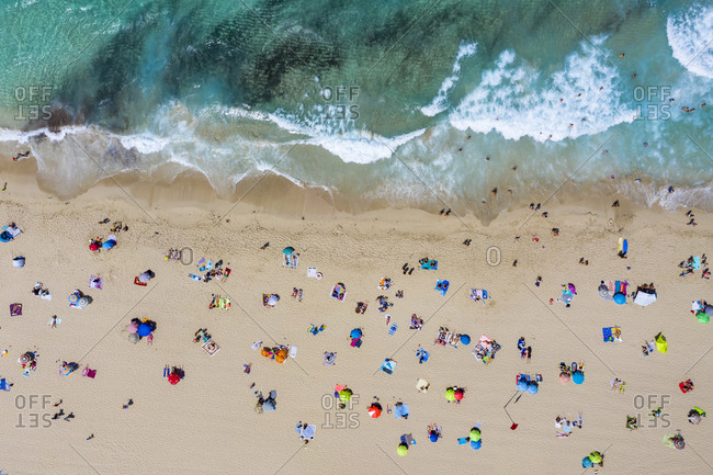 Spain- Mallorca- Cala Mesquida- Aerial view of people relaxing on Cala Agulla beach in summer