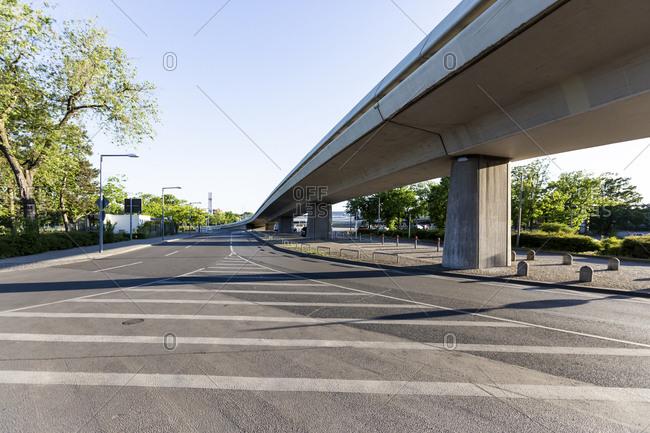 Germany- Berlin- Overpass and empty asphalt road of Berlin Tegel Airport during COVID-19 lockdown