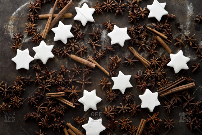 Cinnamon star cookies- cinnamon sticks and star anise on rustic baking sheet