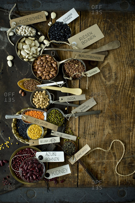 Rustic baking sheet and various types of beans and lentils