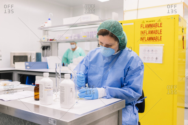 Female pharmacists preparing medicines in hospital laboratory
