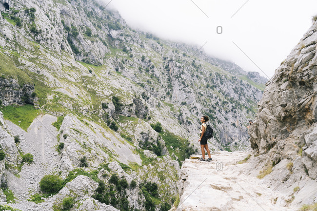 Young woman standing on the mountain path at Ruta Del Cares- Asturias- Spain