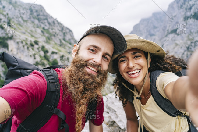 Couple taking selfie while hiking at Ruta Del Cares- Asturias- Spain