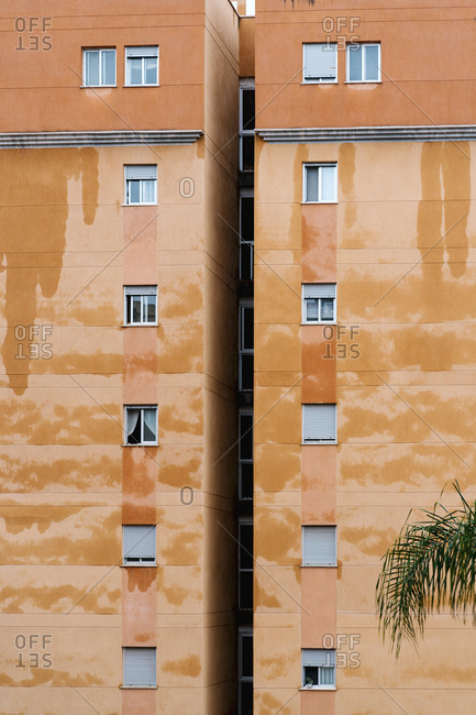 Facade of soaked building during rainy day