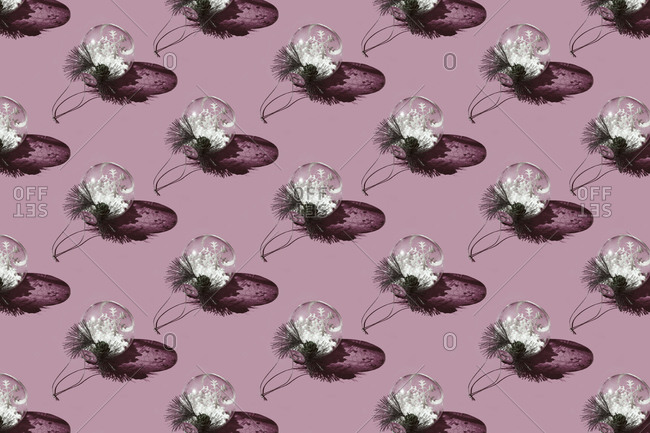 Pattern of Christmas ornaments against pink background