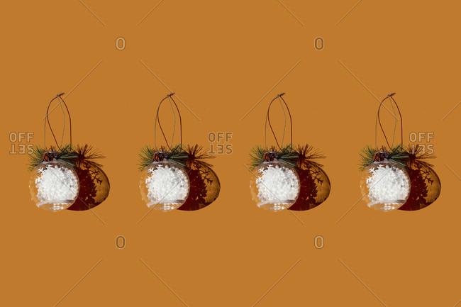 Studio shot of row of Christmas ornaments