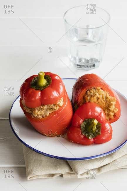 Plate of stuffed bell peppers with spelt