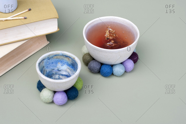 Bowls on DIY coasters made of felt balls