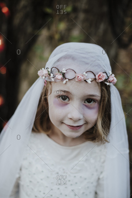 Cute girl wearing costume of corpse bride while standing in forest