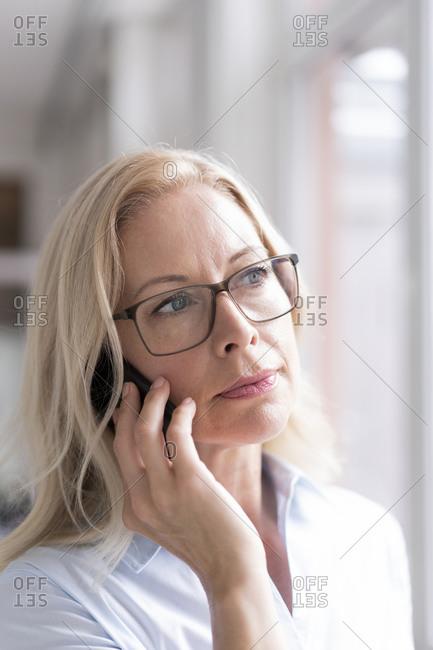 Close-up of female entrepreneur talking over mobile phone
