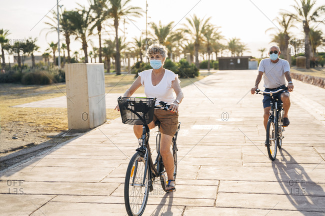Couple cycling at park during pandemic