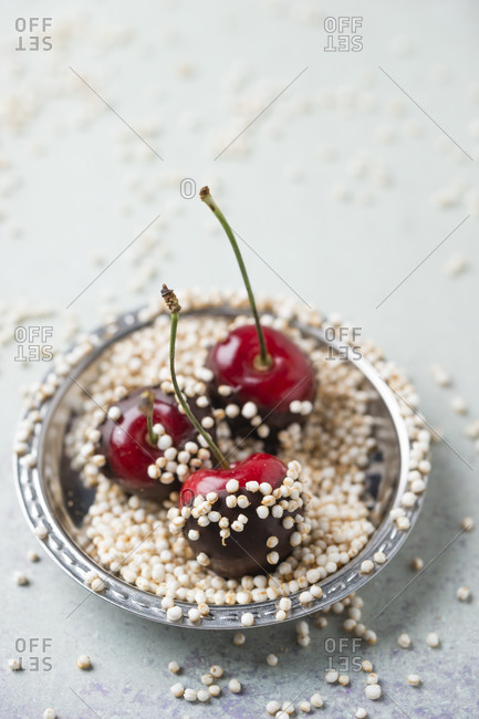 High angle view of chocolate covered cherries and quinoa in plate