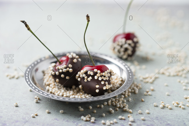 Close-up of chocolate covered cherries and quinoa in plate on table
