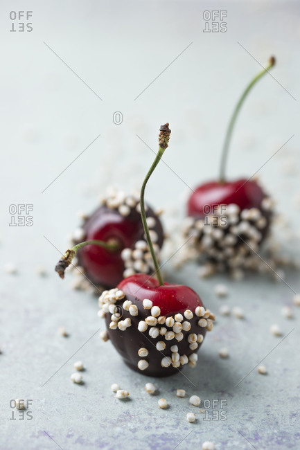 Close-up of chocolate covered cherries and quinoa on table