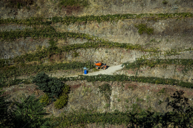 Aerial view of agricultural machine standing in field