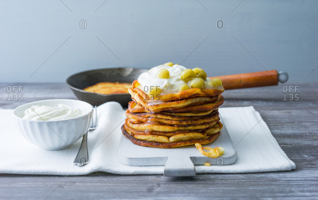 Pancakes with sour cream and gooseberries