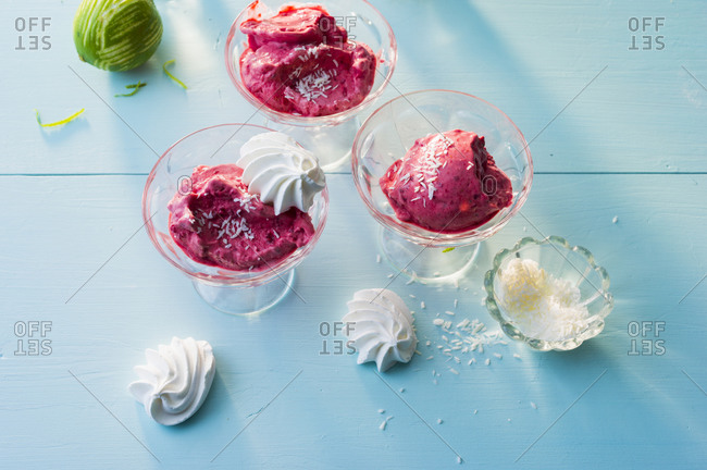 Raspberry ice creams with coconut shreds and meringues