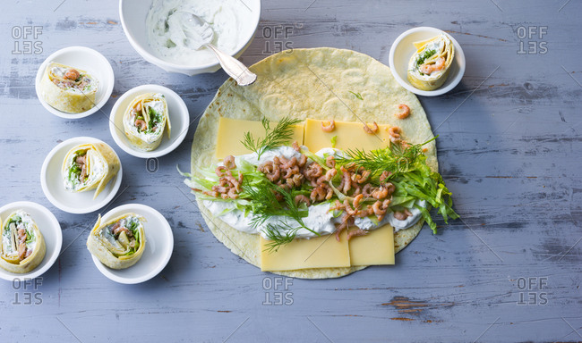 Shrimp wraps with cheese and herbs
