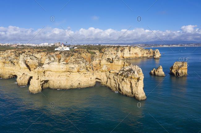Portugal- Algarve- Lagos- Drone view of Ponta da Piedade headland and Farol da Ponta lighthouse