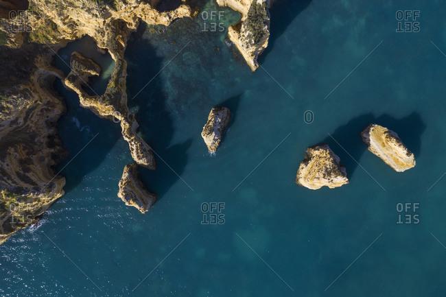 Portugal- Algarve- Lagos- Drone view of sea stacks of Ponta da Piedade headland