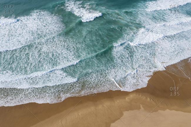Portugal- Algarve- Drone view of Praia do Amado beach