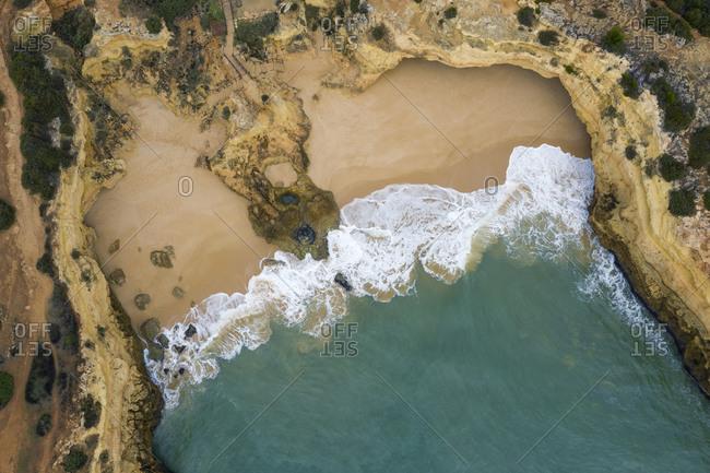 Portugal- Algarve- Lagoa- Drone view of bay and cliffs at Praia de Albandeira