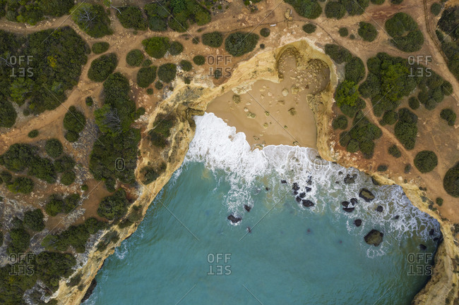 Portugal- Algarve- Lagoa- Drone view of bay and cliffs at Praia da Estaquinha