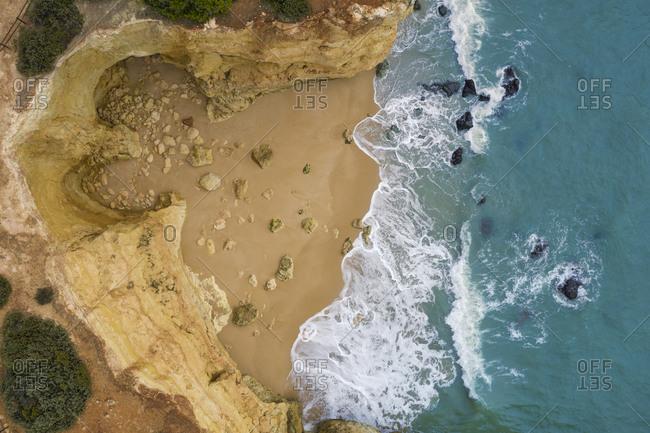 Portugal- Algarve- Lagoa- Drone view of beach and cliffs at Praia da Estaquinha