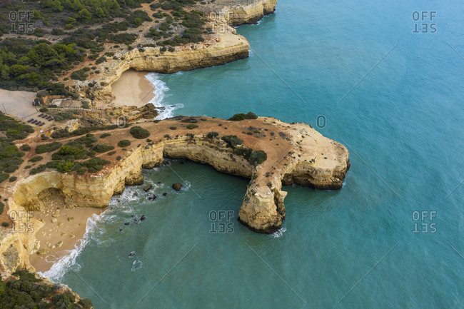 Portugal- Algarve- Lagoa- Drone view of Natural Arch of Albandeira- Praia da Estaquinha and Praia de Albandeira