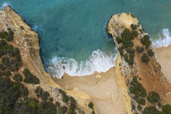 Portugal- Algarve- Lagoa- Drone view of cliffs and beach at Praia da Malhada do Baraco