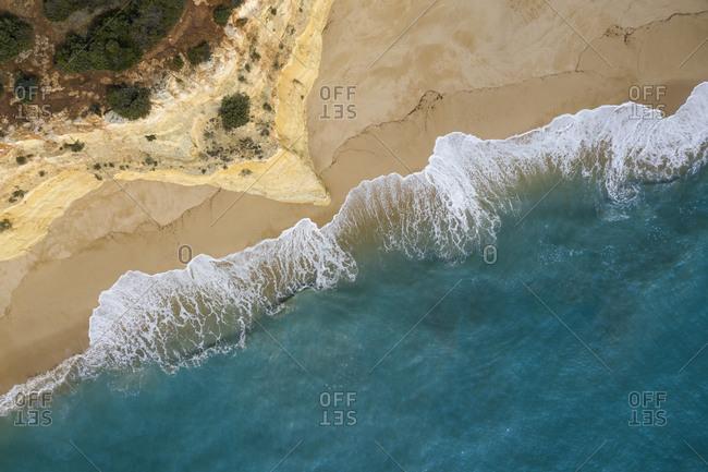 Portugal- Algarve- Lagoa- Drone view of cliff and beach at Praia da Malhada do Baraco