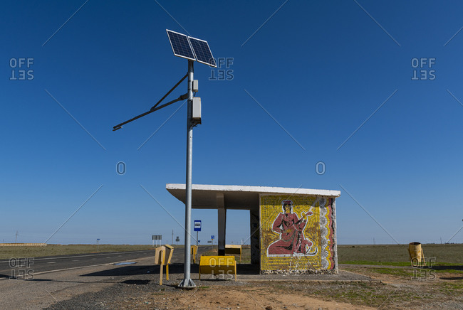 October 3, 2019: Russia- Republic of Kalmykia- Solar panels in front of remote bus stop