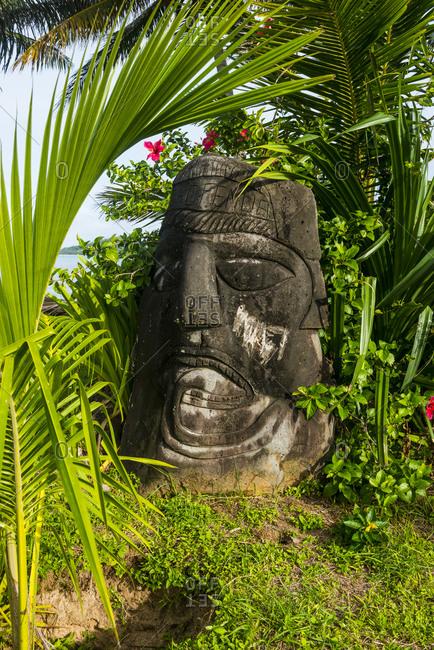 January 17, 2016: France- Wallis and Futuna- Stone sculpture of large human head