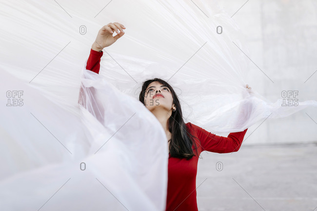 Young Woman looking up while wrapped inside plastic