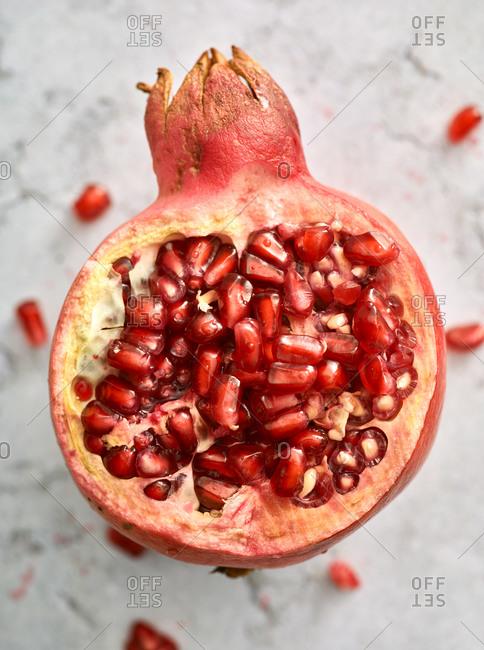 Pomegranate broken open on light surface