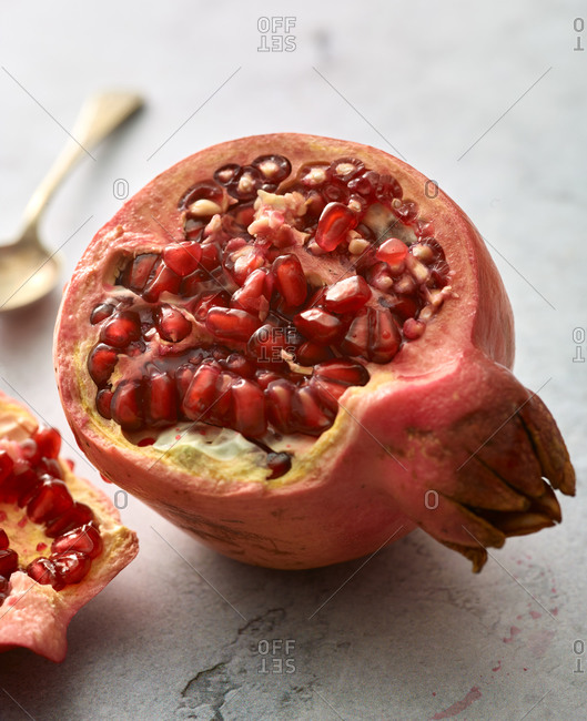 Pomegranate seeds showing in halfed fruit