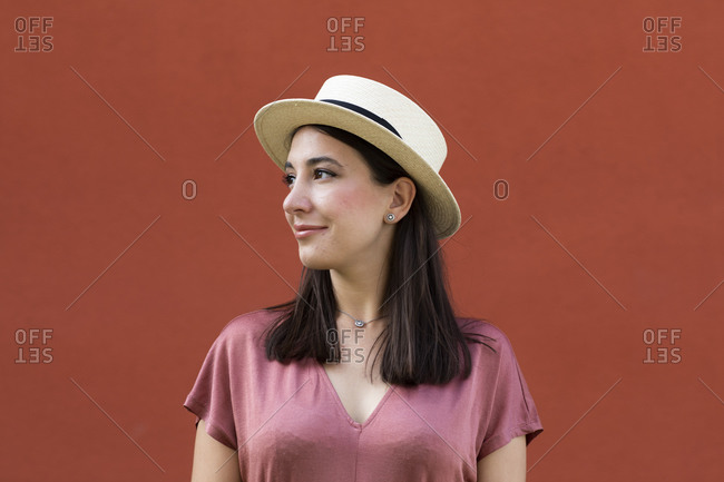 Woman wearing dusty pink top and standing outdoors