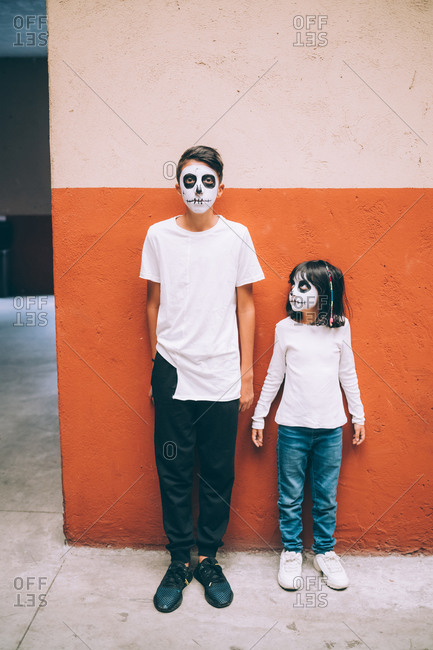 Brother and sister with Halloween face paint