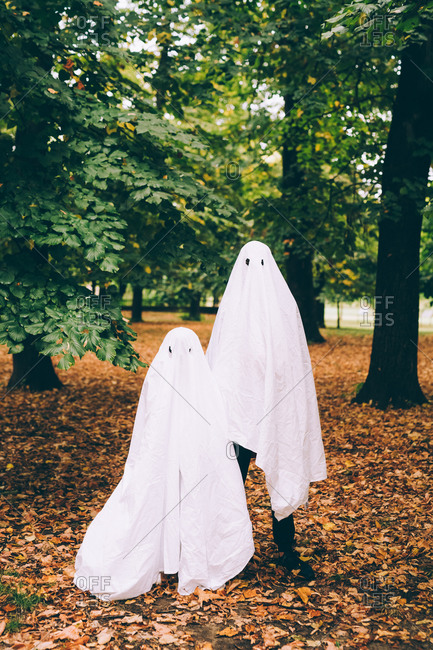 Children in ghost Halloween costumes
