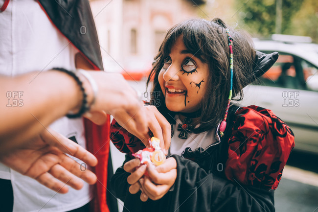 Girl in Halloween costume, trick or treating