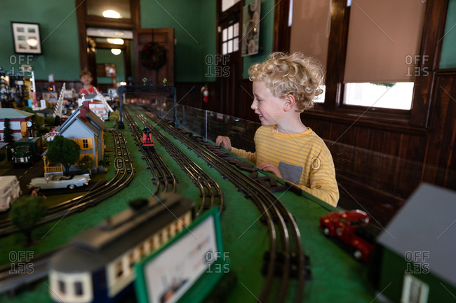 Young boy watching toy trains
