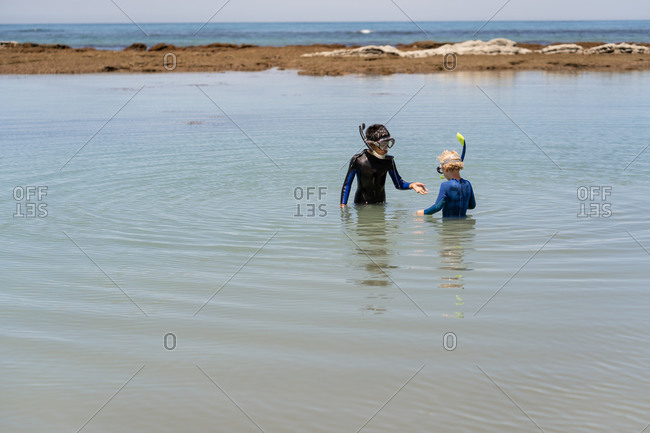 Two boys with snorkles exploring at Hawke's Bay, New Zealand