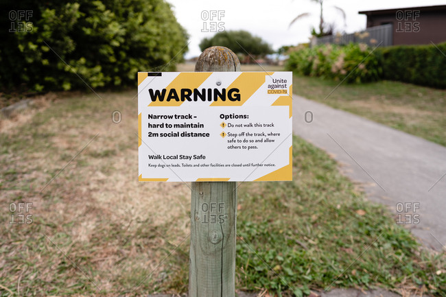 Warning sign at a park entrace during the coronavirus
