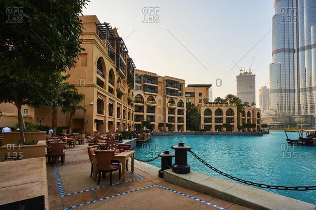 November 21, 2016: Dubai, UAE, Emirates, United Arabic Emirates, Middle East, Africa, fountain place area, souk al bahar, Burj Khalifa at background, Restaurant terrace,