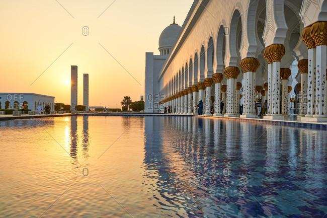 November 23, 2016: Abu Dhabi, UAE, Emirates, United Arab Emirates, Africa, Middle East, Grand Sheikh Zayed Mosque, fountain pool at sunset,