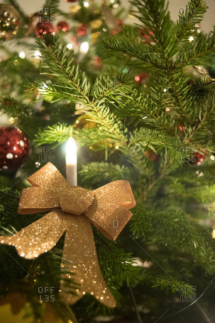 Germany, Bavaria, Christmas, Silent Night, 24. December, Christmas festival, Tree, detail, electric candle, ribbon, evening,