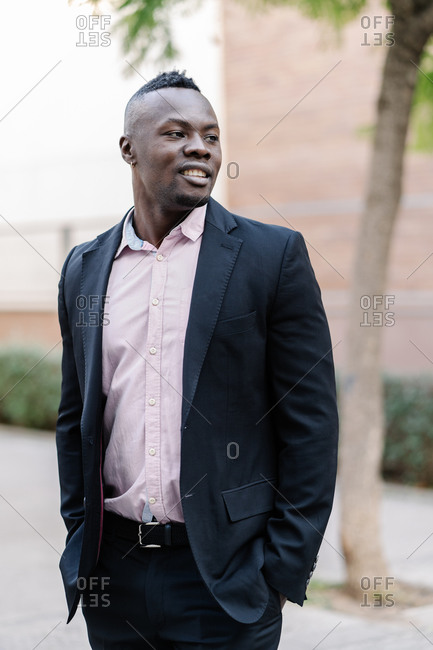 Portrait of a confident and handsome afro businessman in the street