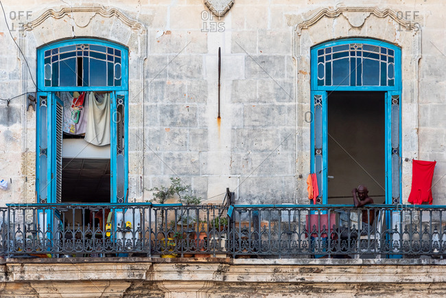 August 23, 2019: A local cuban man looks from his balcony. Havana Cuba