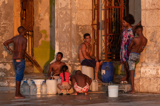September 3, 2019: People filling carafes with water in the streets of Havana. Havana, Cuba