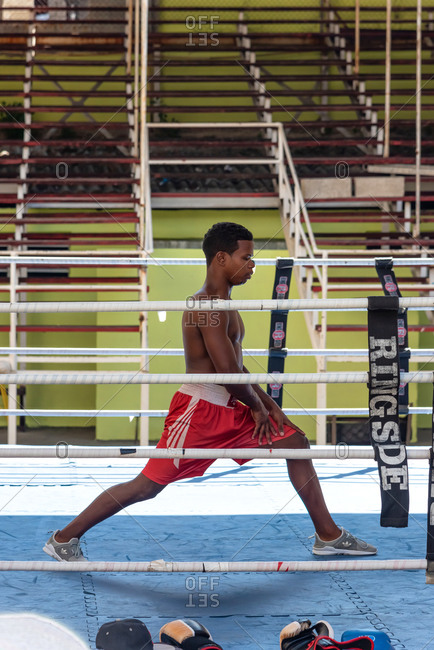 September 4, 2019: Boxer warming up before training in a boxing school with ring. Havana Cuba